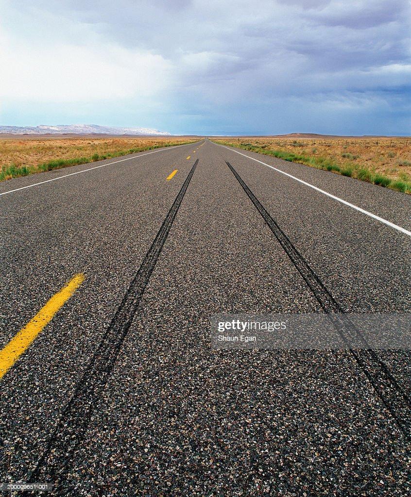 usa utah tyre skid marks on road running through flat landscape