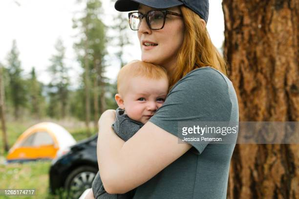 usa, utah, uninta wasatch cache nrtionrl forest, woman holding baby son (6-11 months) during camping - 6 11 months stock pictures, royalty-free photos & images