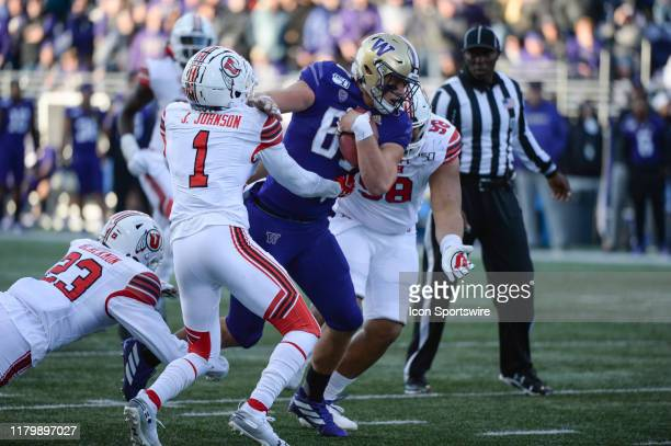Utah Utes defensive back Jaylon Johnson wraps up Washington Huskies tight end Cade Otton during a PAC12 Conference game between the Washington...