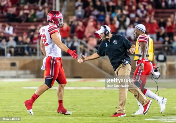 Utah Utes defensive coordinator Morgan Scalley congratulates Utah Utes linebacker Chase Hansen on a stop of the Stanford Cardinal drive in the game...