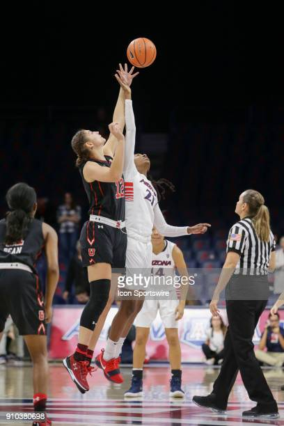 Utah Utes forward Emily Potter and Arizona Wildcats forward Destiny Graham jump to get the tip off during a college women's basketball game between...