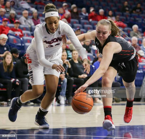 Utah Utes forward Megan Jacobs and Arizona Wildcats forward Kiana Barkhoff go after the lose ball during a college women's basketball game between...