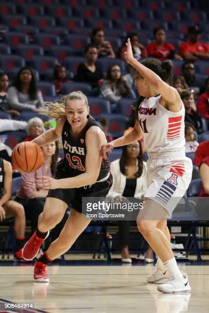 Utah Utes forward Megan Jacobs tries to dribble the ball past Arizona Wildcats forward Kat Wright during a college women's basketball game between...