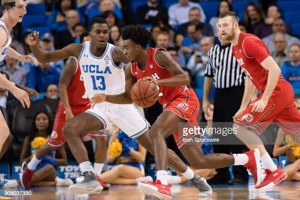 Utah Utes guard Kolbe Caldwell drives the ball inside with UCLA Bruins guard Kris Wilkes defending during the game between the Utah Utes and the UCLA...
