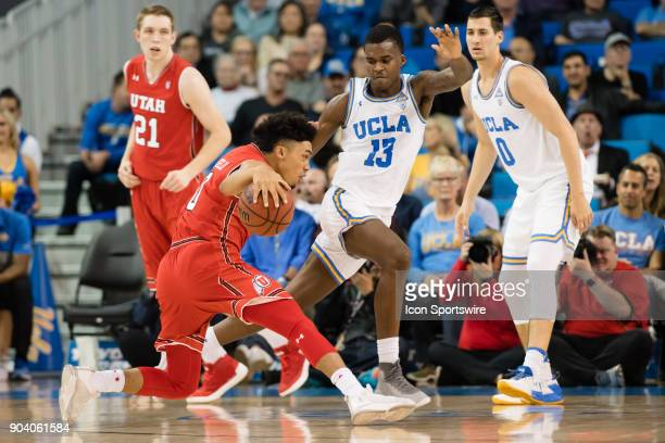 Utah Utes guard Sedrick Barefield drives the ball inside against UCLA Bruins guard Kris Wilkes during the game between the Utah Utes and the UCLA...