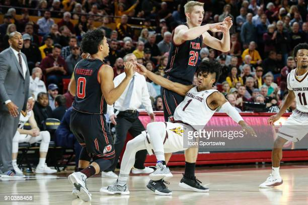 Utah Utes guard Sedrick Barefield knocks down Arizona State Sun Devils guard Remy Martin during the college basketball game between the Utah Utes and...