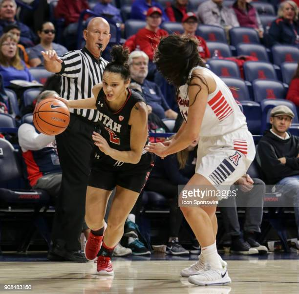Utah Utes guard Tori Williams tries to dribble the ball past Arizona Wildcats forward Kat Wright during a college women's basketball game between...