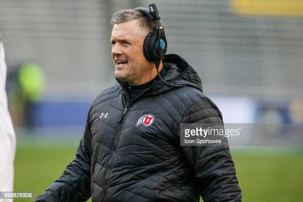 Utah Utes head coach Kyle Whittingham looks to the sidelines during a timeout during the game between the Utah Utes and the West Virginia...