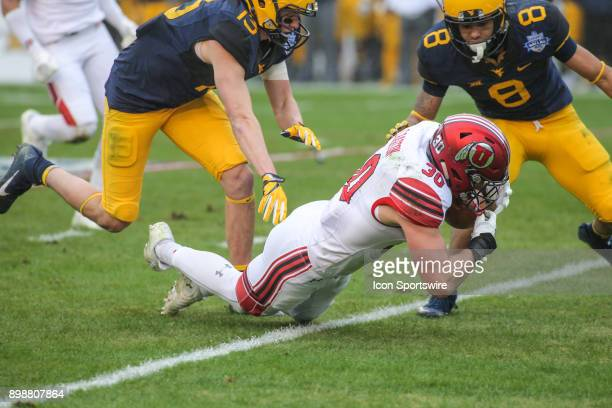 Utah Utes linebacker Cody Barton recovers a muffed punt during the Zaxby's Heart of Dallas Bowl game between Utah and West Virginia on December 26 at...