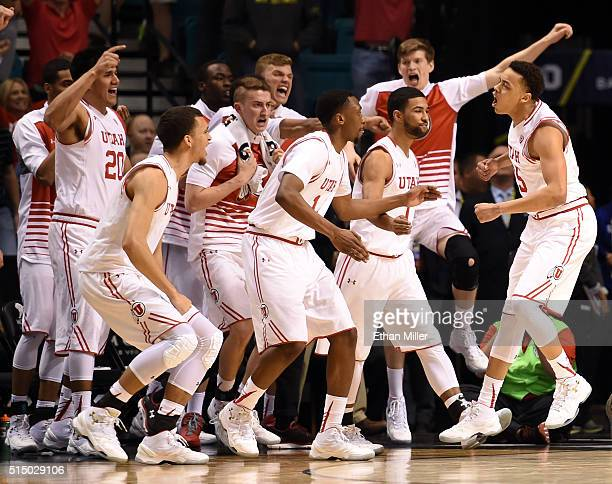Utah Utes players react after Lorenzo Bonam of the Utes hit a layup at the buzzer to send their semifinal game of the Pac-12 Basketball Tournament...