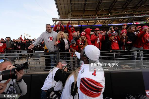 Utah Utes quarterback Tyler Huntley celebrates a Utah win with fans after a PAC12 Conference game between the Washington Huskies and the Utah Utes on...