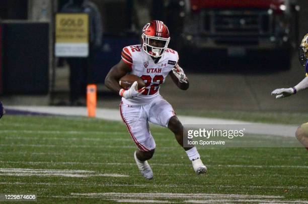 Utah Utes running back Ty Jordan runs the ball during a PAC12 football game between the Utah Utes and the Washington Huskies on November 28 at Husky...