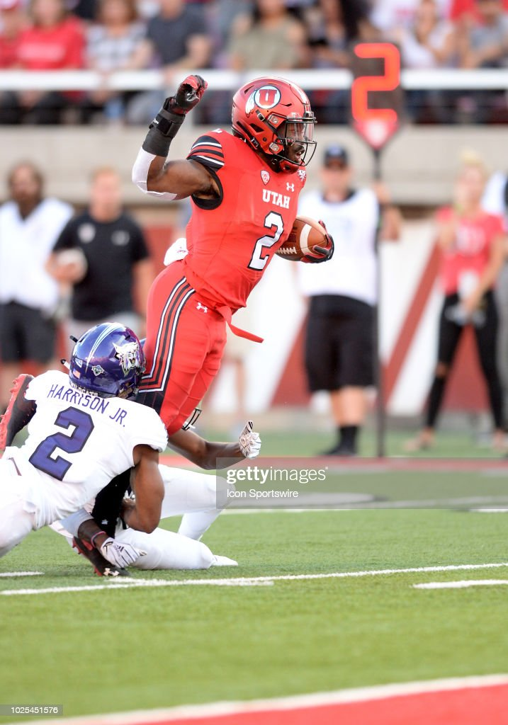 Utah Utes Running Back Zack Moss Tries To Score As Weber State