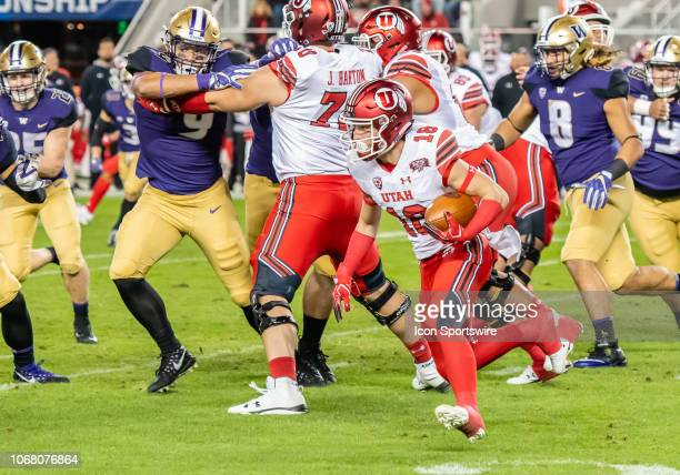 Utah Utes wide receiver Britain Covey moves around a block by Utah Utes offensive lineman Jackson Barton during the game between the Washington...