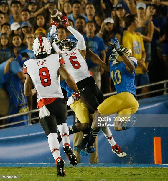 Utah Utes wide receiver Dres Anderson catches a 42yard touchdown pass from Utah Utes quarterback Kendal Thompson with UCLA Bruins Ishmael Adams and...