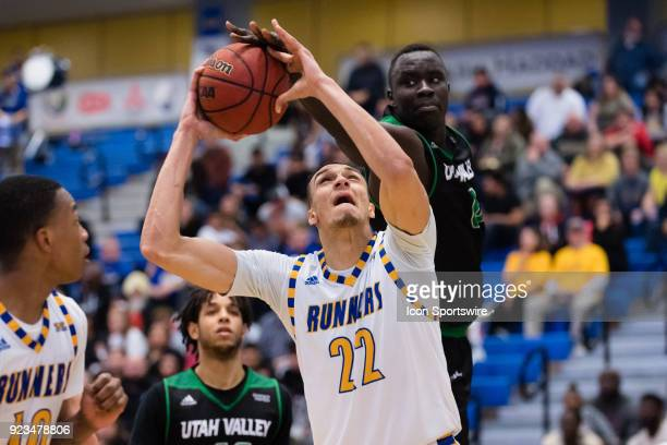 Utah Valley Wolverines center Akolda Manyang gets a hand on the ball as Cal State Bakersfield Roadrunners center Moataz Aly goes to the basket during...
