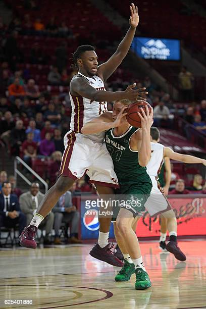 Utah Valley Wolverines forward Zach Nelson gets blocked by Denver Pioneers forward CJ Bobbitt during the first half November 23 2016 at Magness Arena