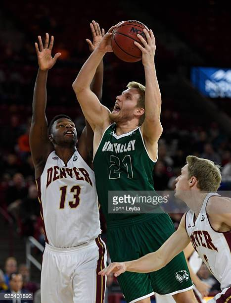 Utah Valley Wolverines forward Zach Nelson goes up for a shot on Denver Pioneers forward CJ Bobbitt during the first half November 23 2016 at Magness...