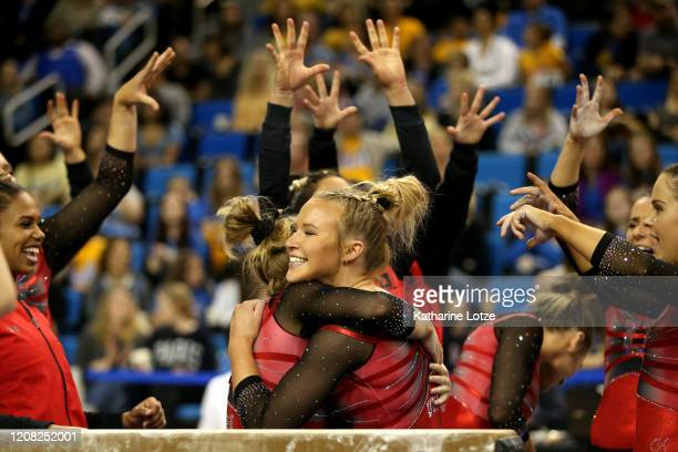 Utah's Abby Paulson reacts with teammates after performing on beam during a meet against the UCLA Bruins at Pauley Pavilion on February 23, 2020 in...