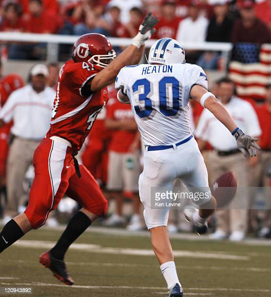 Utah's Grady Marshall blocks the punt attempt of Air Force punter Donny Heaton durint the second quarter at RiceEccles Stadium in Salt Lake Thursday...