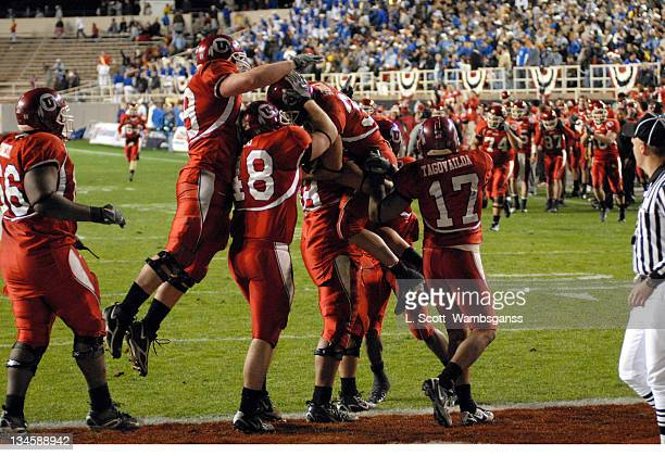 Utah's players celebrate Eric Weddle's touchdown against Tulsa during the Armed Forces Bowl played at Amon Carter Stadium in Ft Worth Texas on...