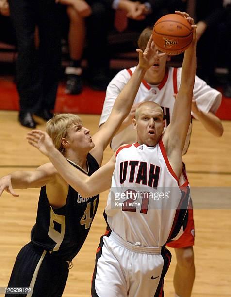 Utahs Shaun Green grabs a rebound in front of Colorados Sean Kowal at the Huntsman Center in Salt Lake City Tuesday Nov. 21, 2006.