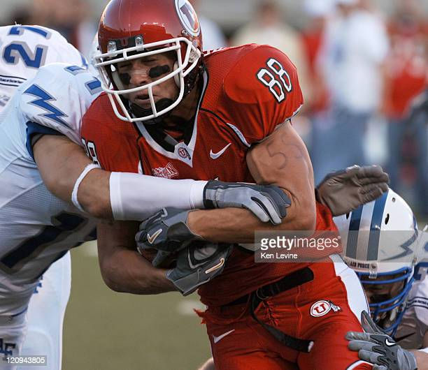Utah's Travis LaTendresse gets tackled by Air Force's Bobby Giannini during the second quarter at RiceEccles Stadium Thursday Sept 22 2005 Utah...