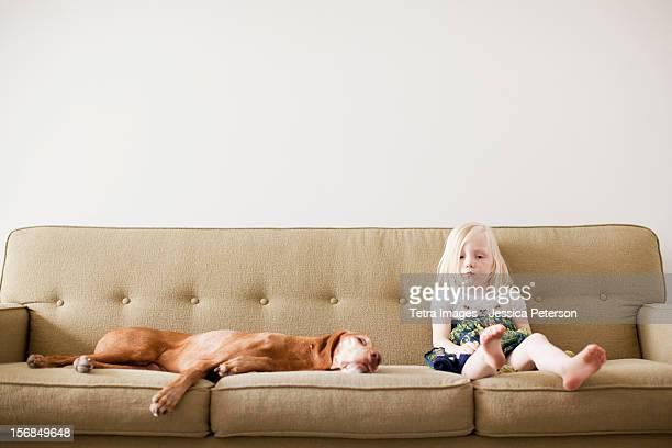 USA, Utah,Salt Lake City, Girl(4-5) on couch with dog