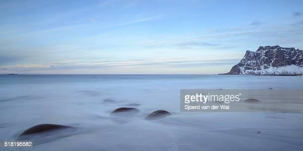 "utakleiv beach in the lofoten archipel in norway at the end of a winter day - ""sjoerd van der wal"" ストックフォトと画像"