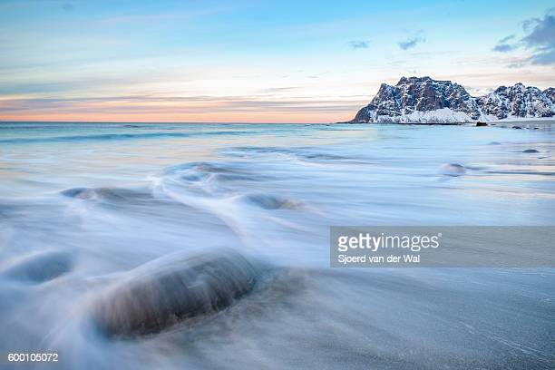 Utakleiv beach in the Lofoten archipel in Norway at the end of a winter day