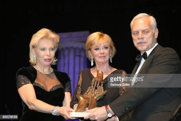 Ute Ohoven and Liz Mohn with prize at the UNESCO Benefit Gala for Children 2008 at Hotel Maritim on November 1 2008 in Cologne Germany