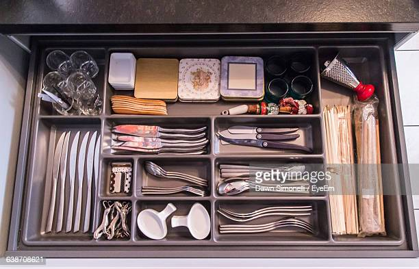 utensils in open drawer in kitchen - drawer stock pictures, royalty-free photos & images