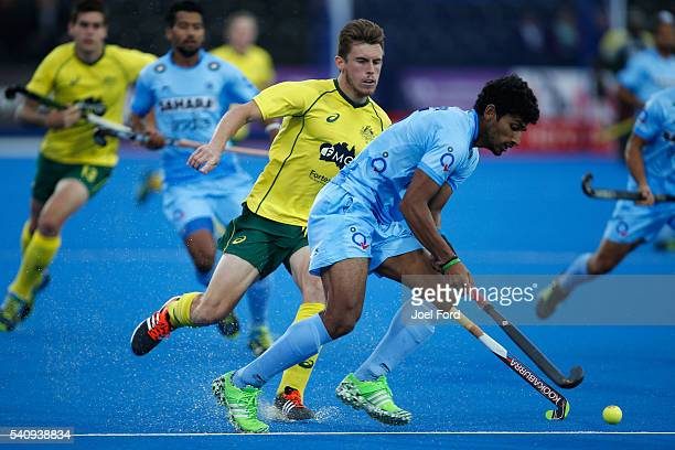 Uthappa Sannuvanda of India carries the ball while being chased by Tristan White of Australia during the FIH Men's Hero Hockey Champions Trophy 2016...