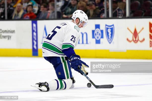 Utica Comets defenceman Brogan Rafferty controls the puck during the third period of the American Hockey League game between the Utica Comets and...