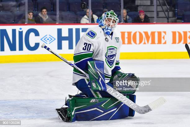 Utica Comets goalie Thatcher Demko looses sight of the puck in the air during the Utica Comets versus the Laval Rocket game on January 10 at Place...