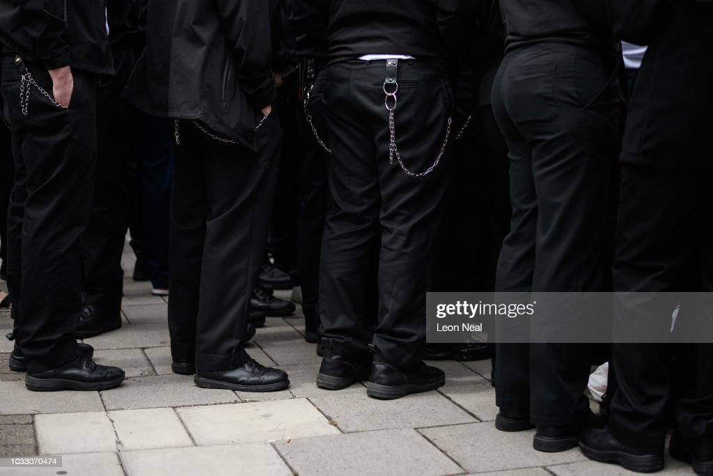Utility belts and keychains are seen on uniformed officers as prison staff gather outside HM Prison Bedford during an unofficial protest on September 14, 2018 in Bedford, England. The Prison Officers Association called for staff to stage an immediate walk-out this morning demanding the government improve safety in jails and reduce overcrowding and violence among inmates.