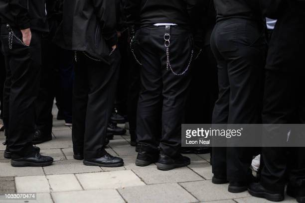 Utility belts and keychains are seen on uniformed officers as prison staff gather outside HM Prison Bedford during an unofficial protest on September...