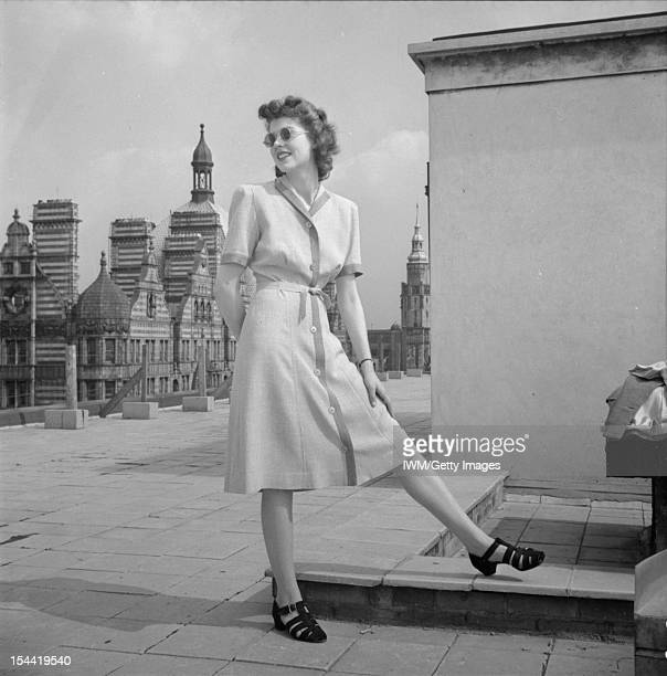 Fashion Restrictions In Wartime Britain A model poses on a Bloomsbury rooftop to show off her twotone Atrima dress costing 7 coupons circa 1943