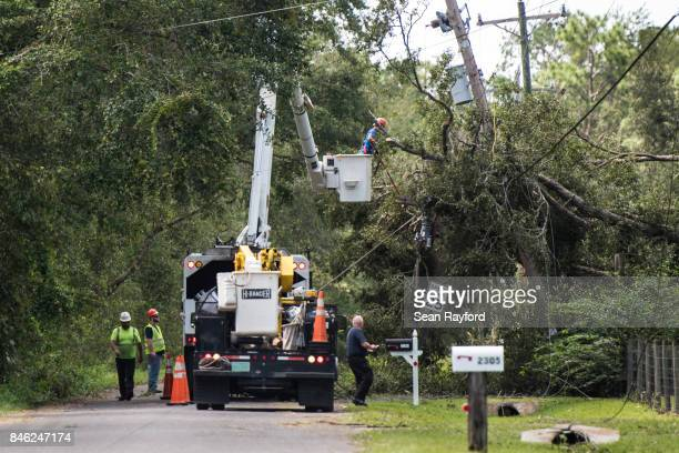 A utility crew repairs lines damaged by Hurricane Irma September 12 2017 in Hastings Florida United States The storm brought flooding to areas not...