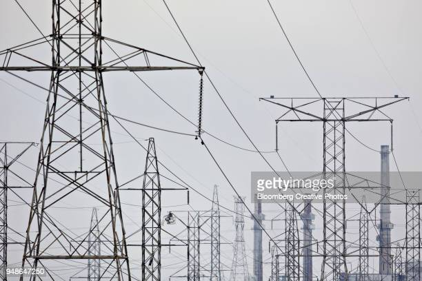 A utility crew works on a transmission tower