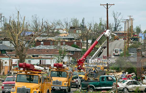 Utility crews from Empire District Electric Company work on restoring electricity in the central section of Joplin, Missouri, on Thursday, May 26...
