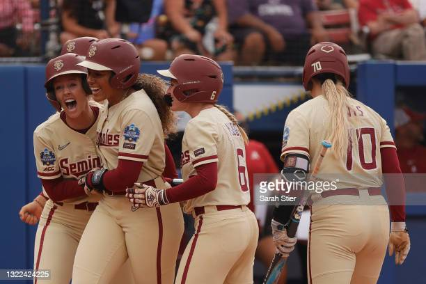 Utility Elizabeth Mason of the Florida St. Seminoles reacts with teammates after hitting a three-run home run during the first inning of Game 14 of...