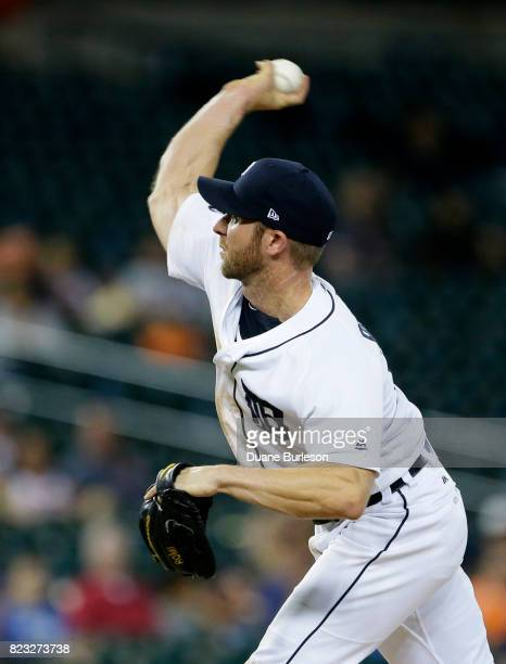 Utility player Andrew Romine of the Detroit Tigers pitches during the ninth inning after pitcher Bruce Rondon of the Detroit Tigers was ejected after...