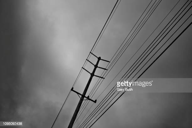utility pole and cables - blackout picture stock pictures, royalty-free photos & images