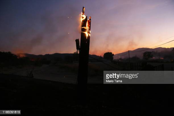 A utility pole burns during the Tick Fire on October 24 2019 in Canyon Country California The fire has burned at least 3700 acres thus far
