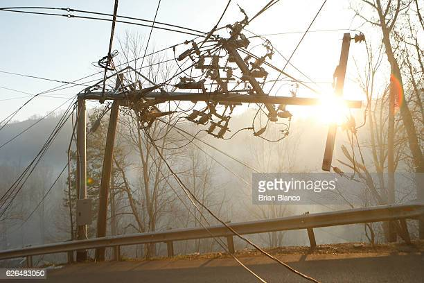 A utility pole is left damaged as fires smolder nearby after a wildfire November 29 2016 in Gatlinburg Tennessee Thousands of people have been...