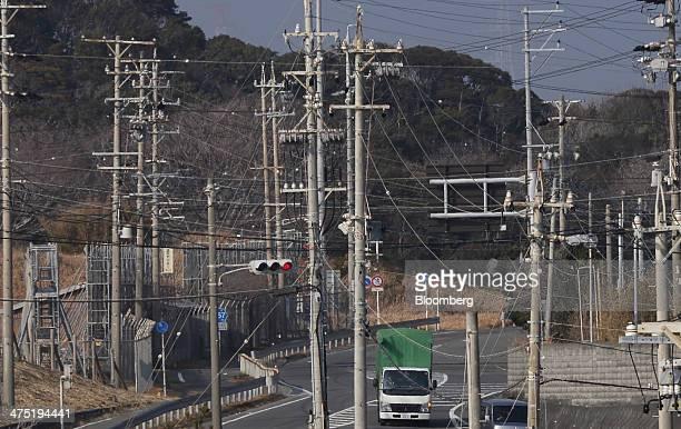 Utility poles stand near Chubu Electric Power Co's Hamaoka nuclear power station unseen in Omaezaki Shizuoka prefecture Japan on Wednesday Feb 26...