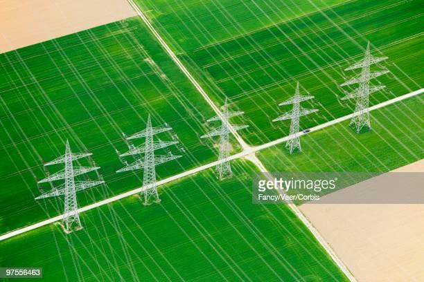 Utility towers between fields