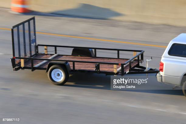 utility trailer being pulled on the highway - trailer stock pictures, royalty-free photos & images