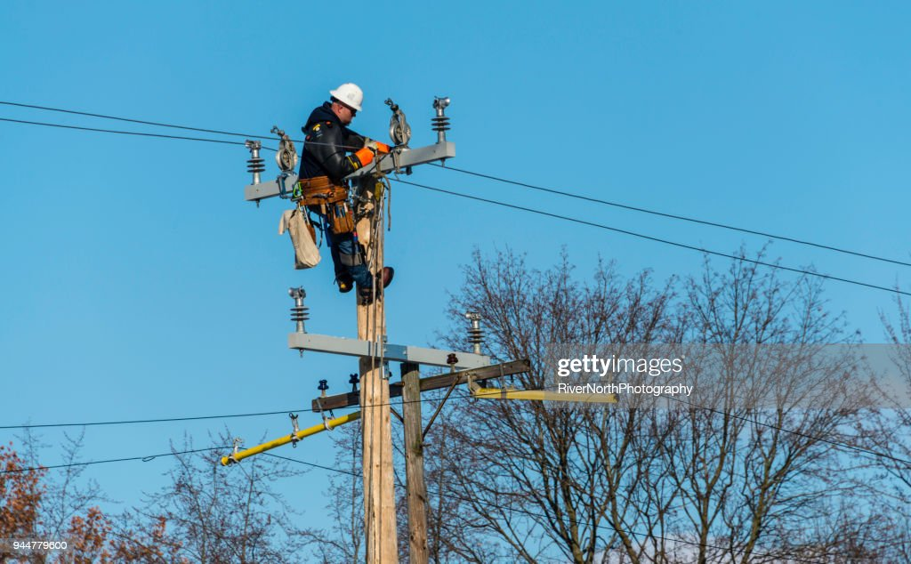 Utility Worker on Pole : Stock Photo